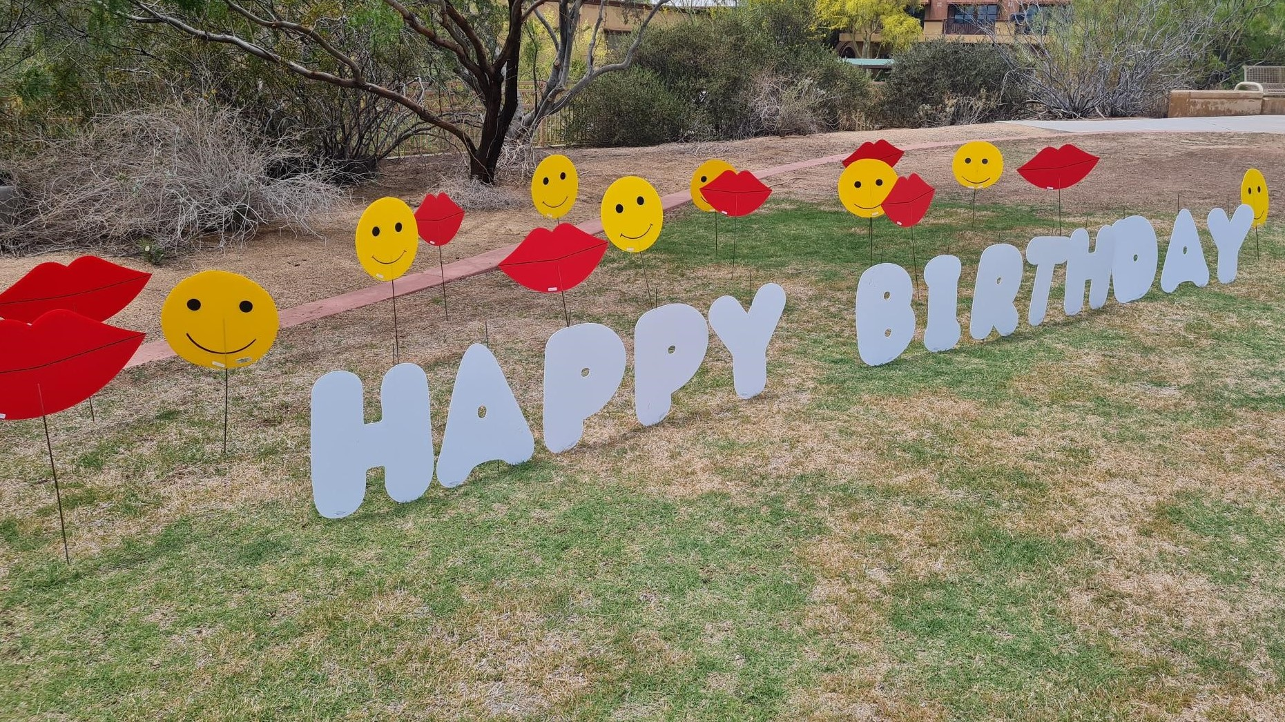 Happy birthday yard card with kisses and smileys