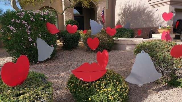 Bells, big red hearts and kisses anniversary decorations in yard