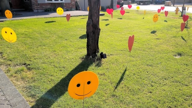 big red hearts and smiles decorations in yard