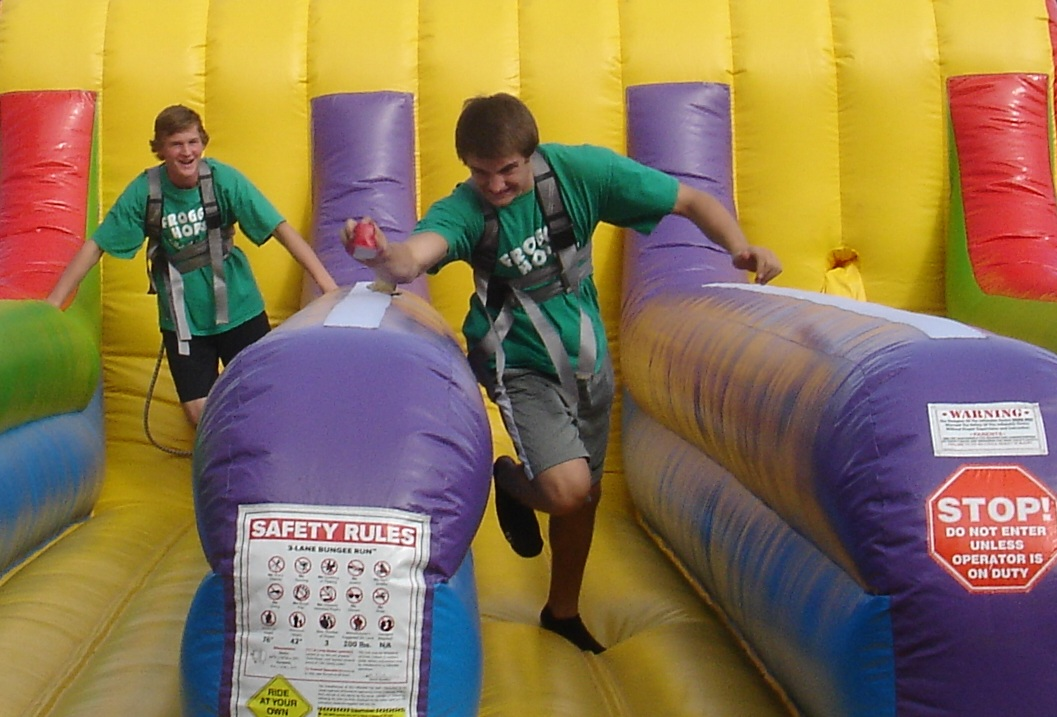 2 High school boys on 3-Lane Bungee Run
