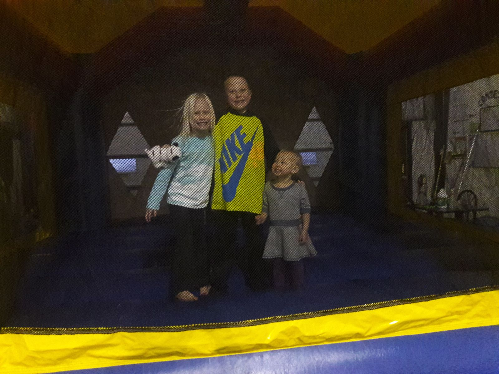 3 Kids inside Justice League Bounce House