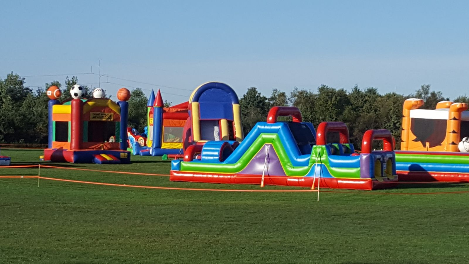 31' Wacky 7-Element Obstacle Course with other Bounce House Rentals at church event.