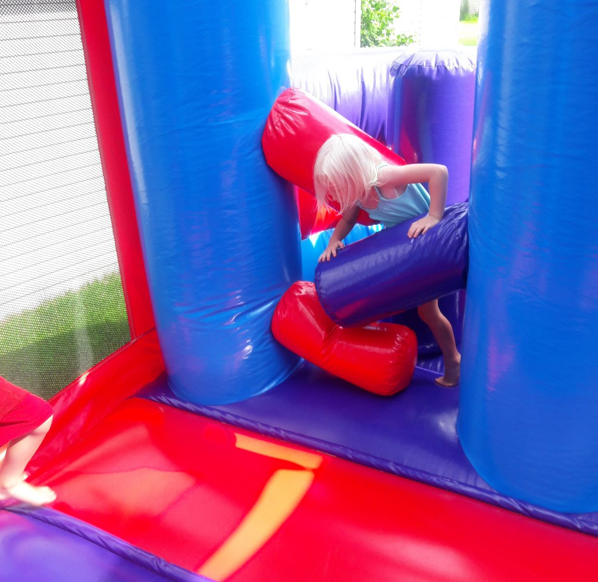Inflatable obstacles inside combo bounce house rental