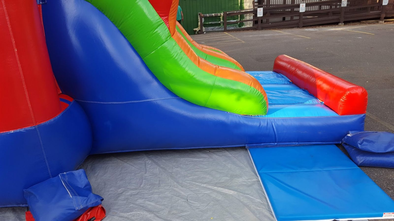 Bounce house exit surrounded by mats for safety