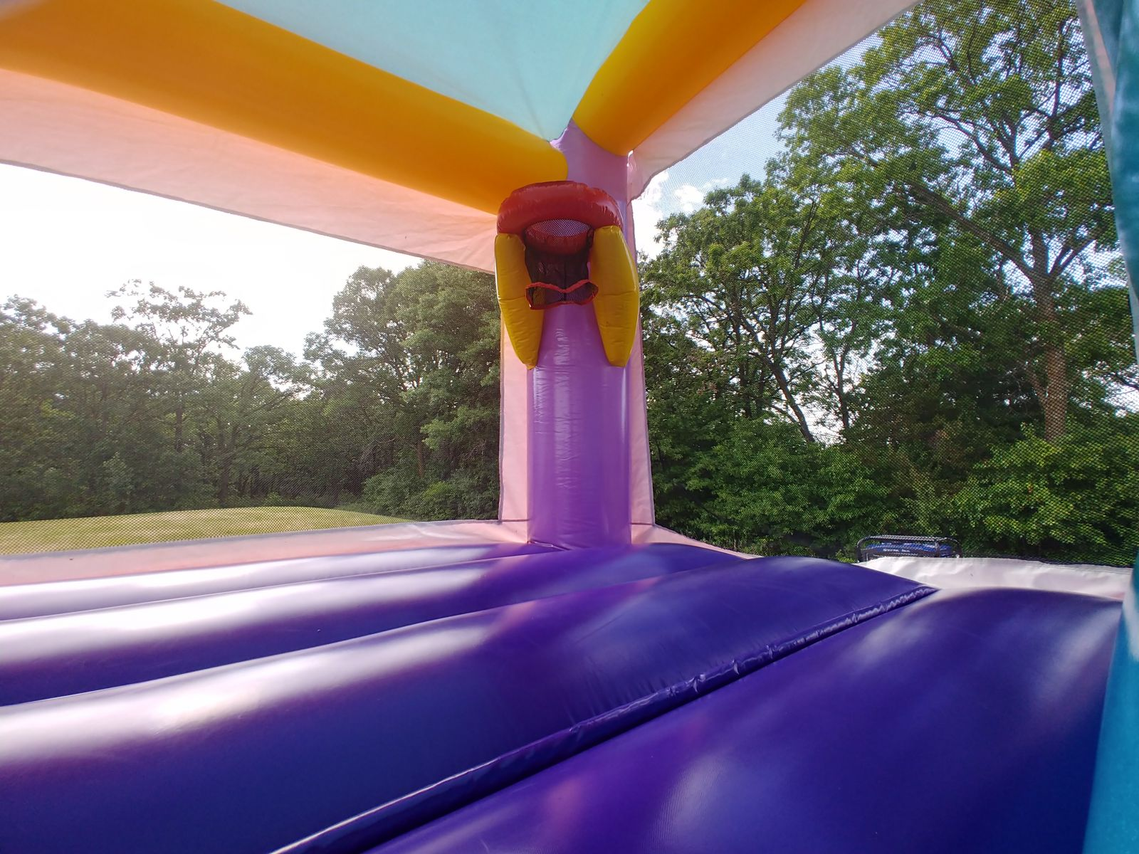 Bounce house with basketball hoop inside