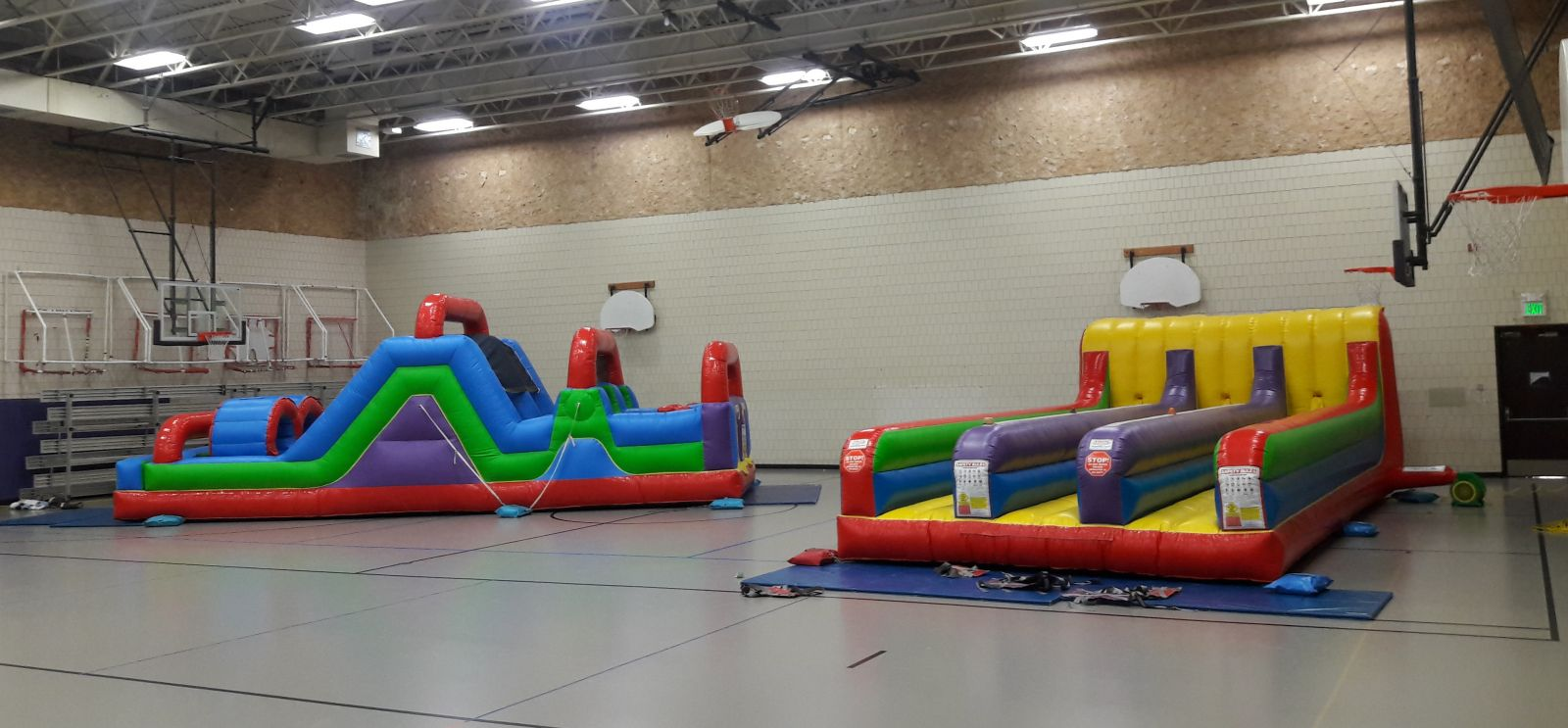 Inflatable 3-Lane Bungee Run and Obstacle Course in School Gym