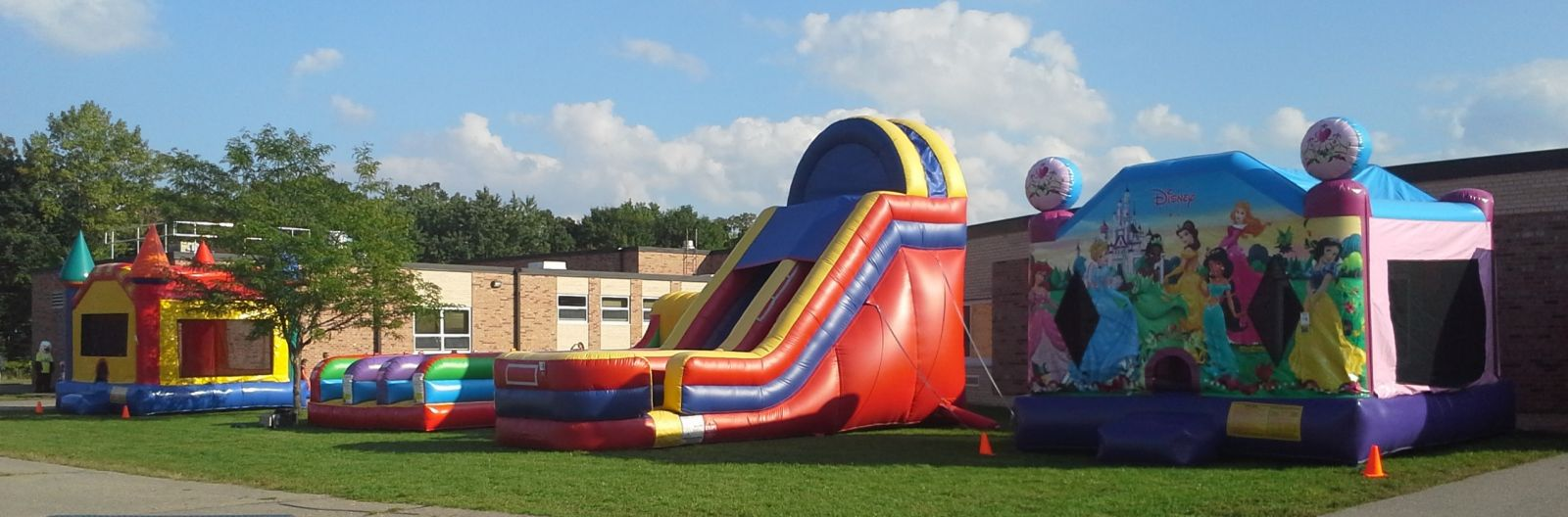 School carnival with Disney Princess Bounce House, GIANT Slide, Bungee Run, and Castle