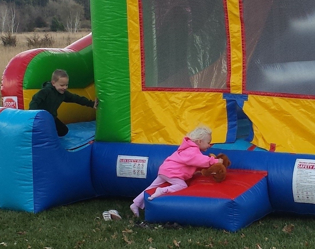 Children playing on Froggy Hops Inflatable Castle Combo