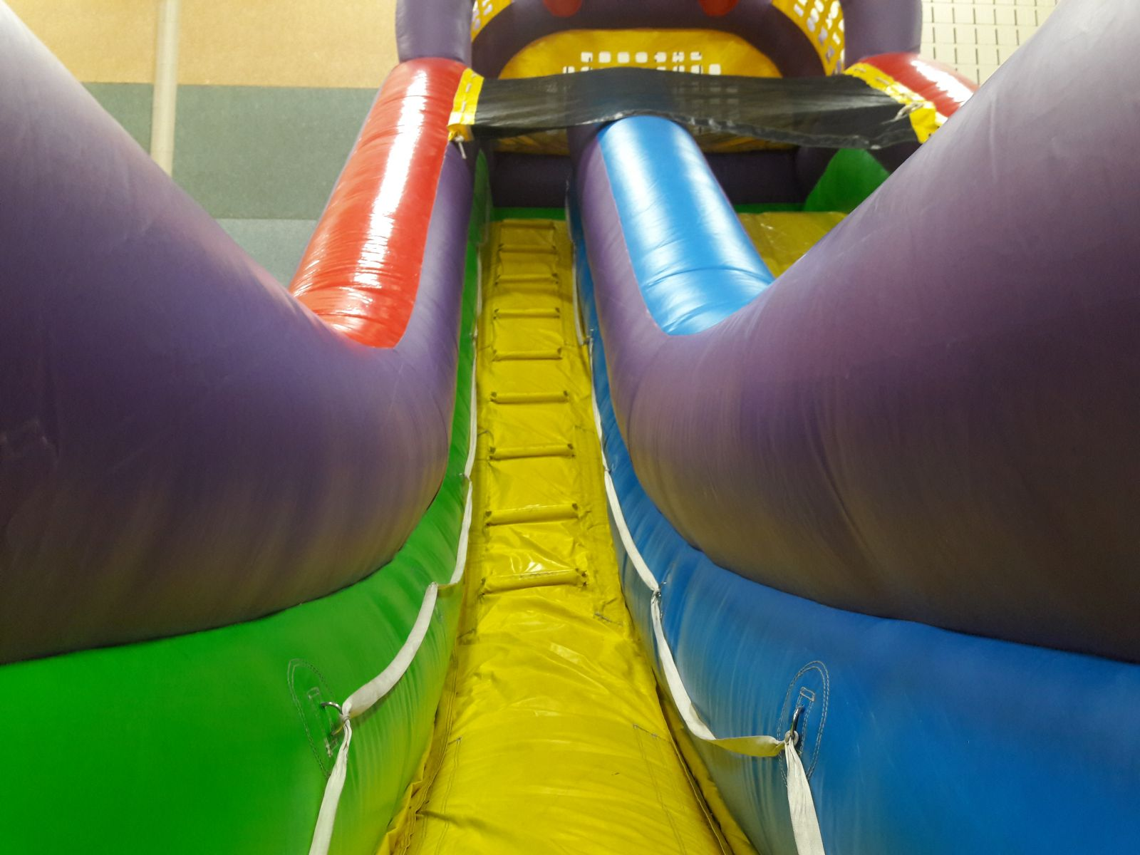 Climbing wall to the top of the 18 foot tall Ultimate Dry Slide Inflatable Rental