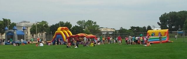 3-Lane Bungee Run, Obstacle course, and bounce house at city festival.