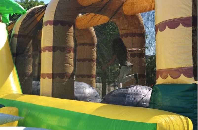 Giant inflatable ball challenge inside obstacle course bouncy house