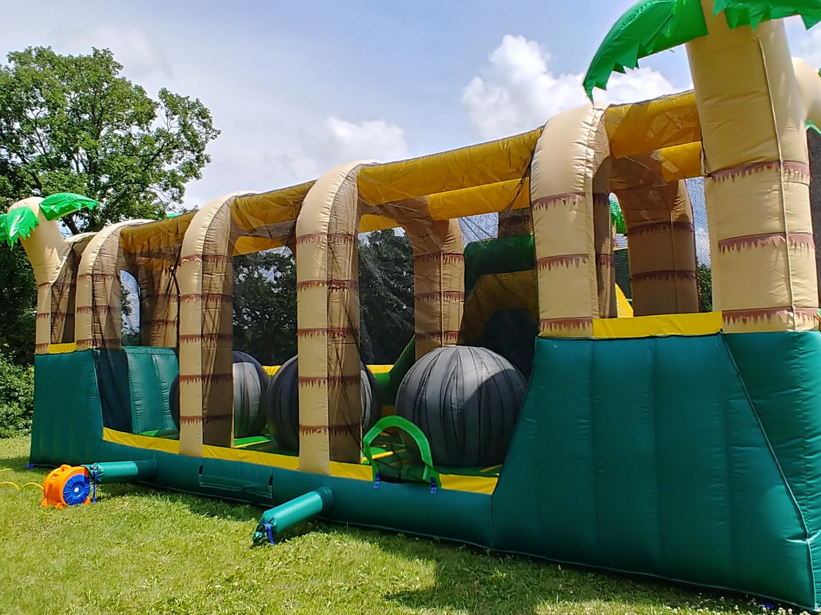 Giant inflatable ball challenge inside Hop N' Rock Obstacle Course