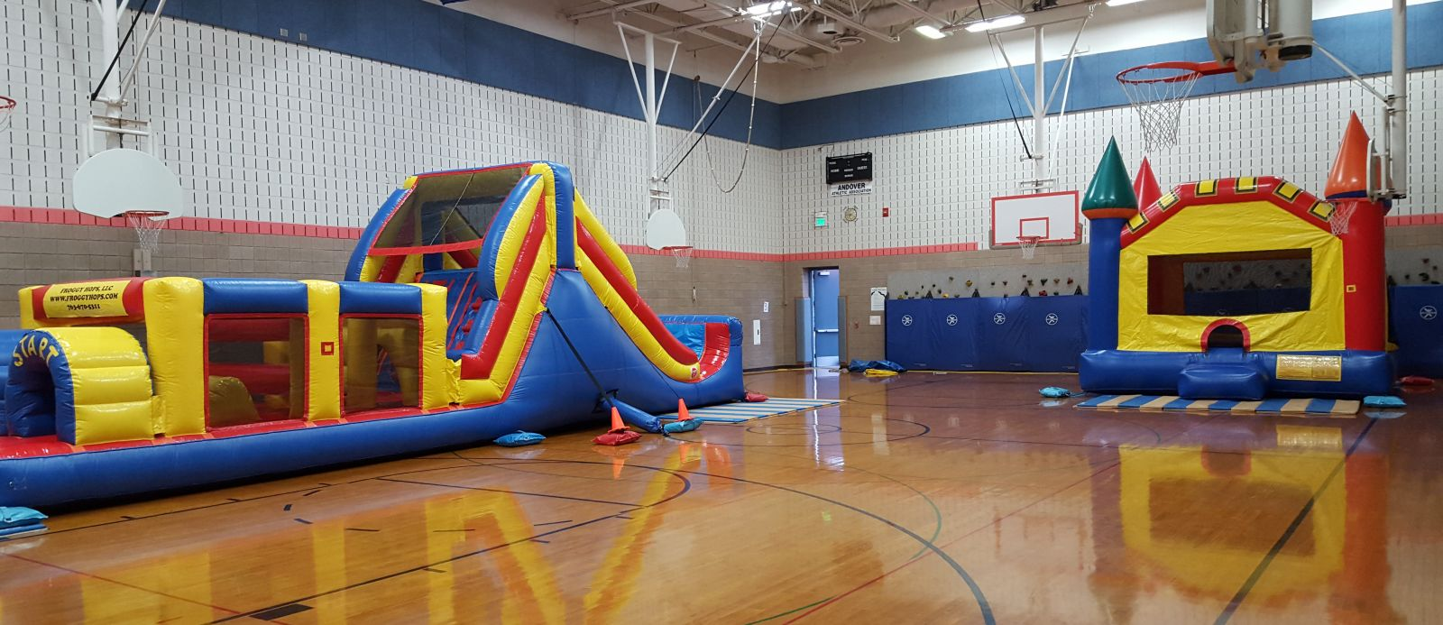 Inflatable Obstacle Course and Bounce House in school gym