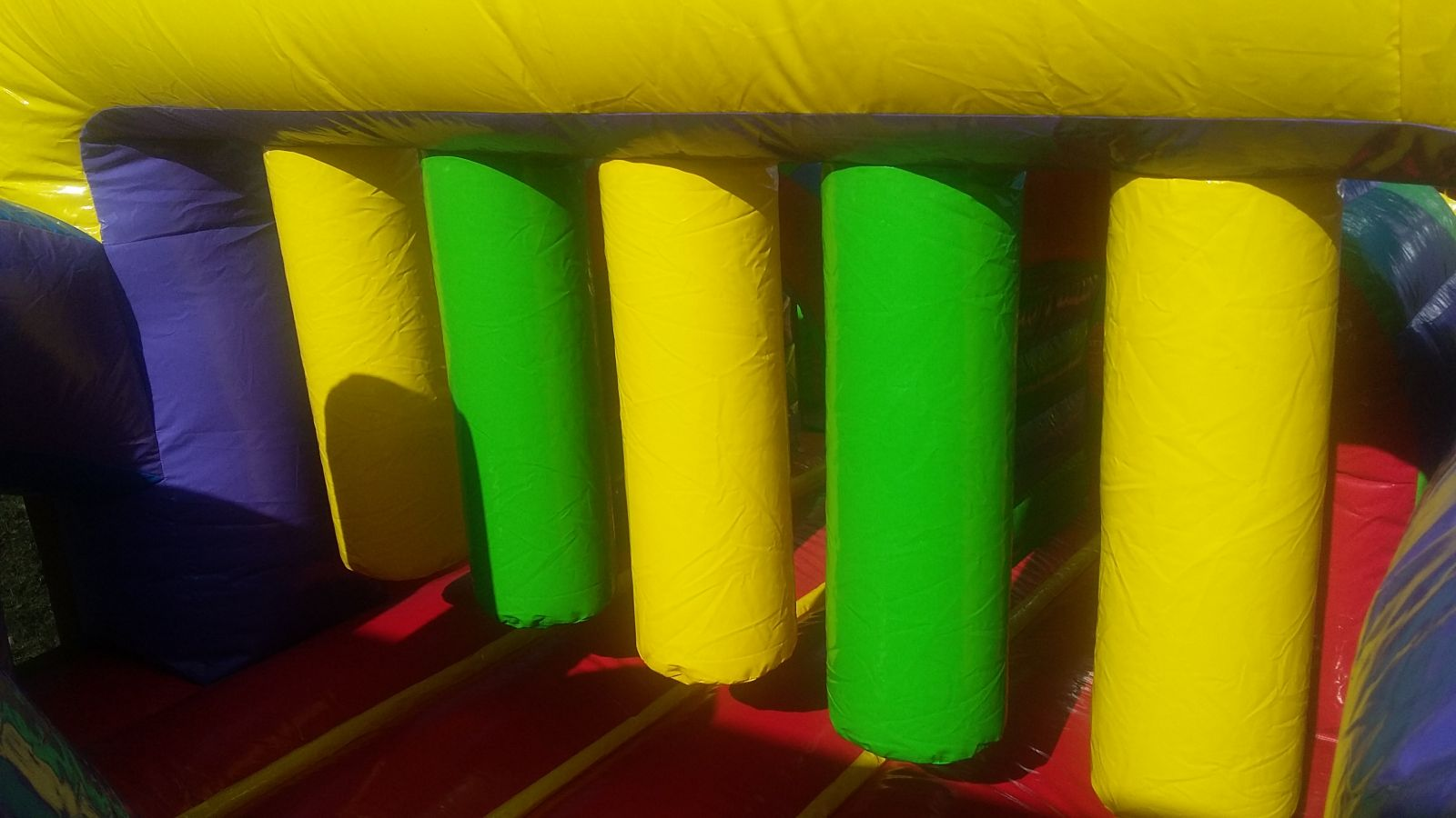 Inflatable haning bars on obstacle course