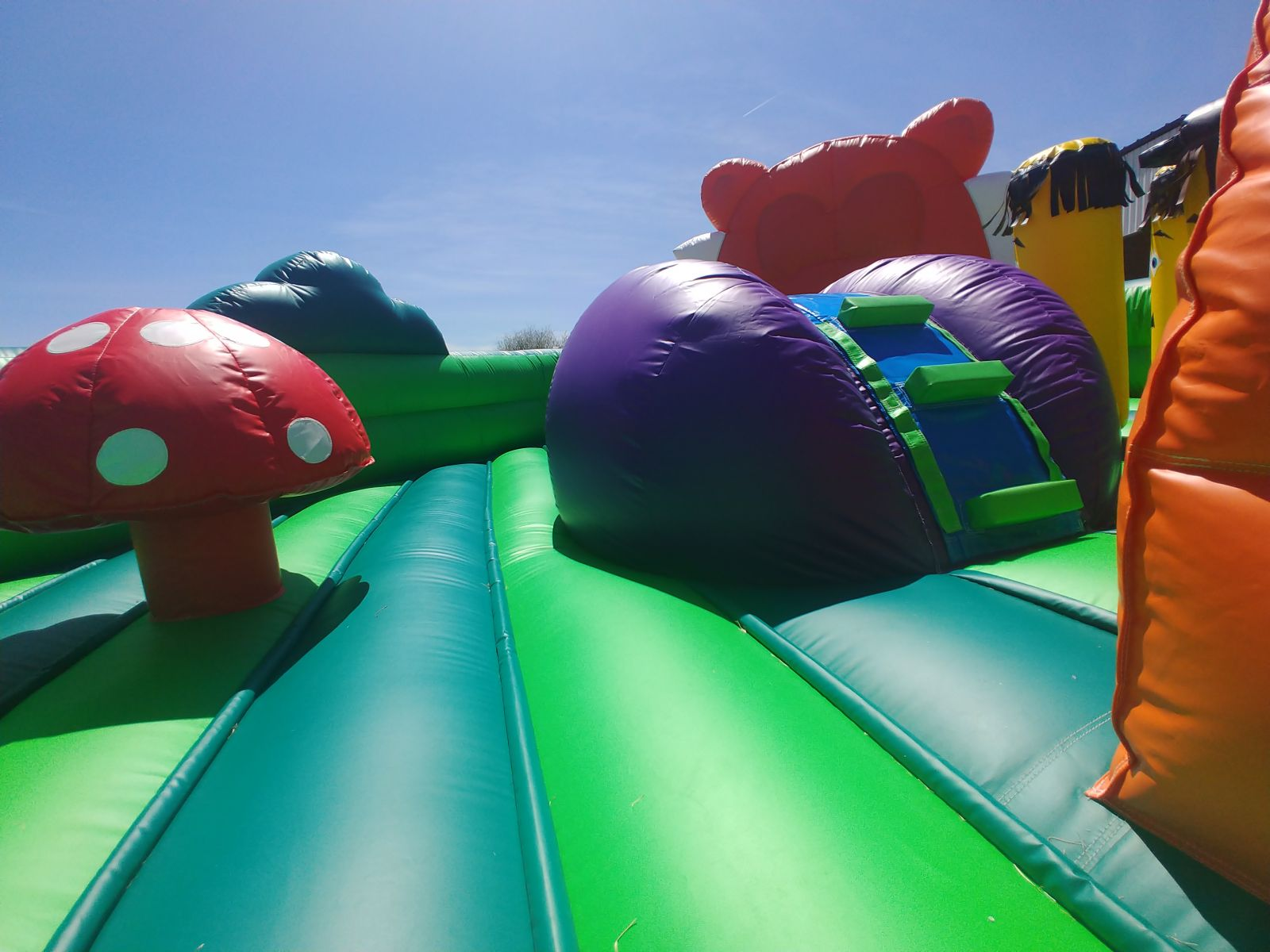 Toddler climbing wall and slide within toddler playland bounce house rental
