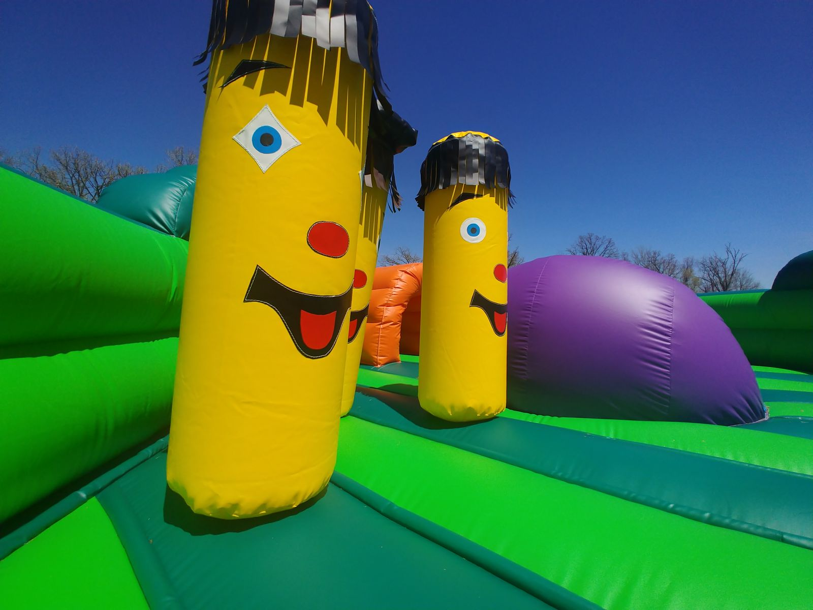 Inflatable obstacles inside bounce house rental for small children.