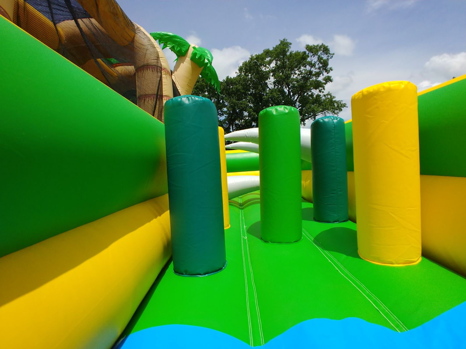 Inflatable pop-up obstacles within Tropical Hop N' Rock Obstacle Course