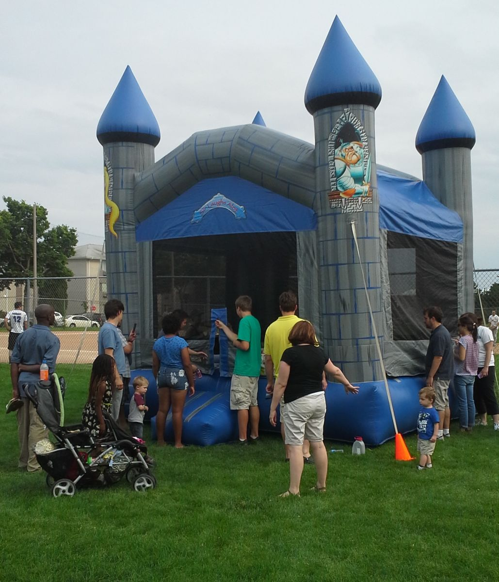 Froggy Hops attendant helps organize kids in bounce house line