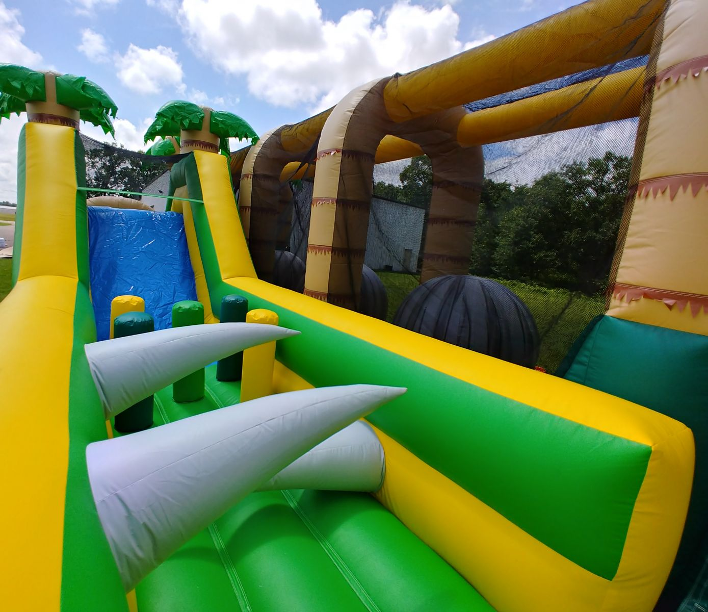 Obstacle course slide and inflatable challenges