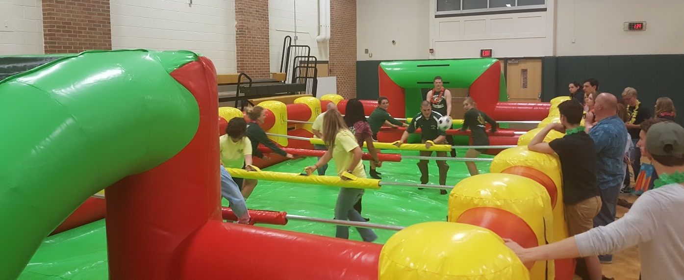 Kids playing in inflatable human foosball indoor