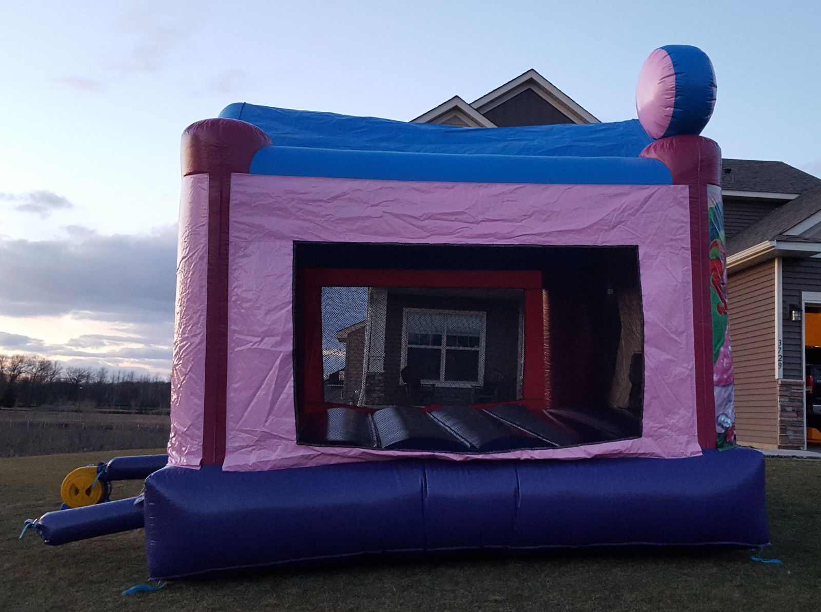 Side-view of Disney Princess Bounce House