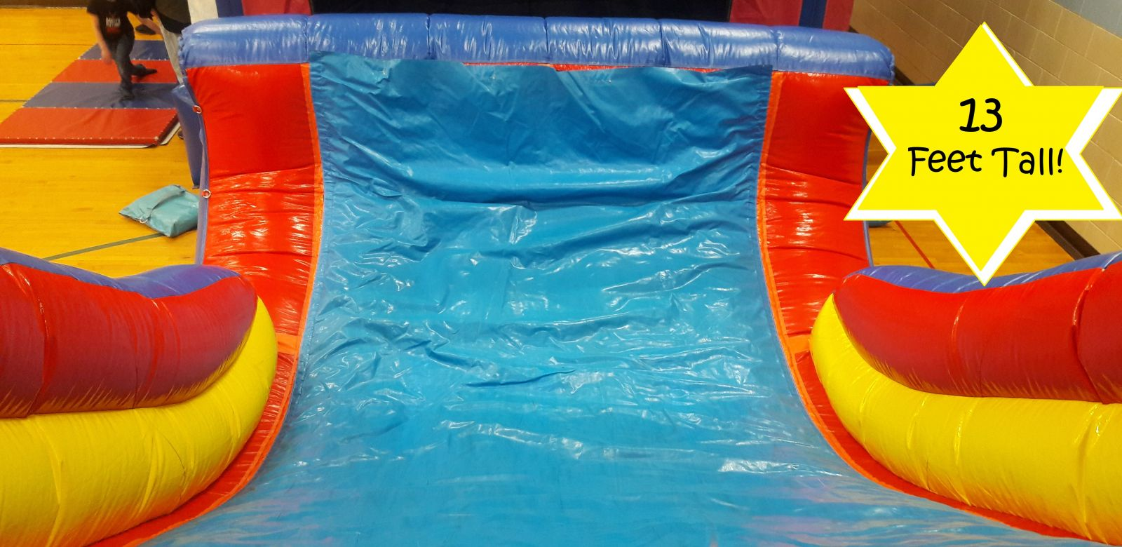 Slide view from the top of the climbing wall on the inflatable obstacle course