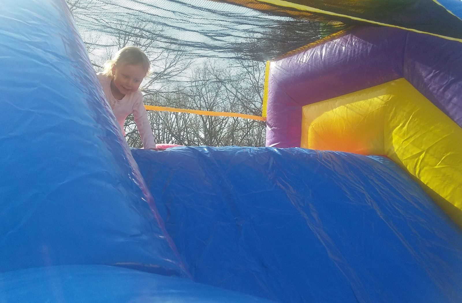 Slide with small girl on obstacle course
