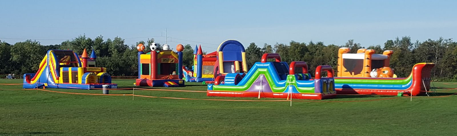 Sports Bounce house and other inflatables at field event by Froggy Hops