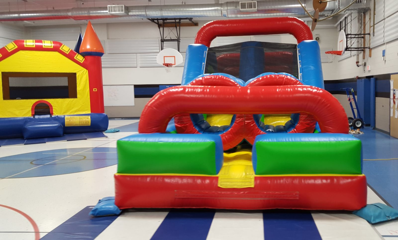 Obstacle Course and Bounce House in school gym
