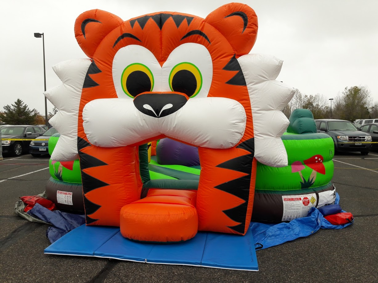 Toddler combo inflatable setup in parking lot and safely secured