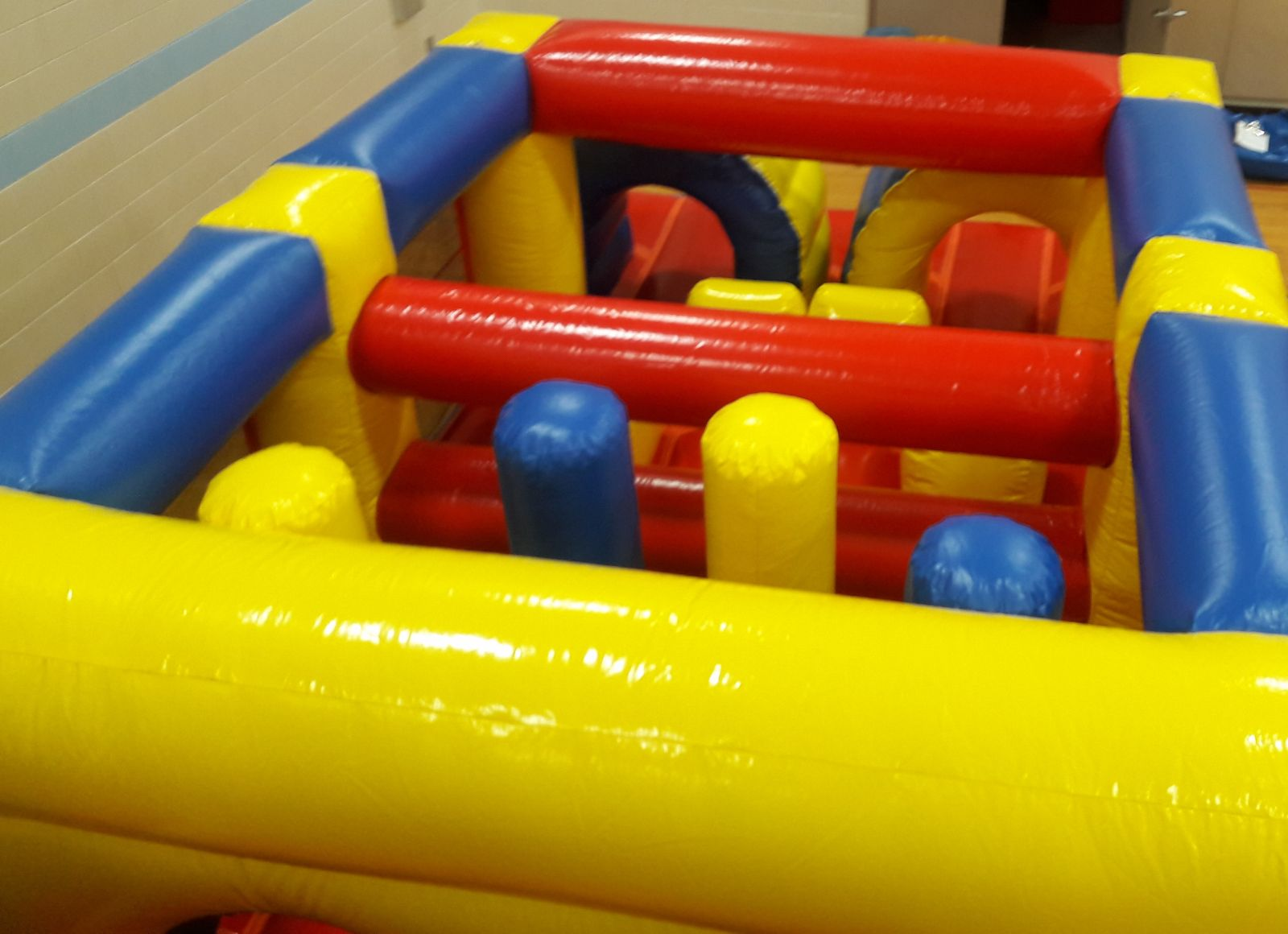 Top-view of obstacles inside inflatable obstacle course rental