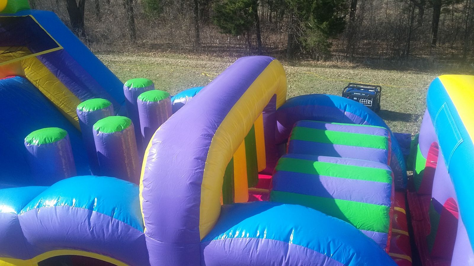 Tunnels, archways, and inflatable popups inside obstacle course bounce house