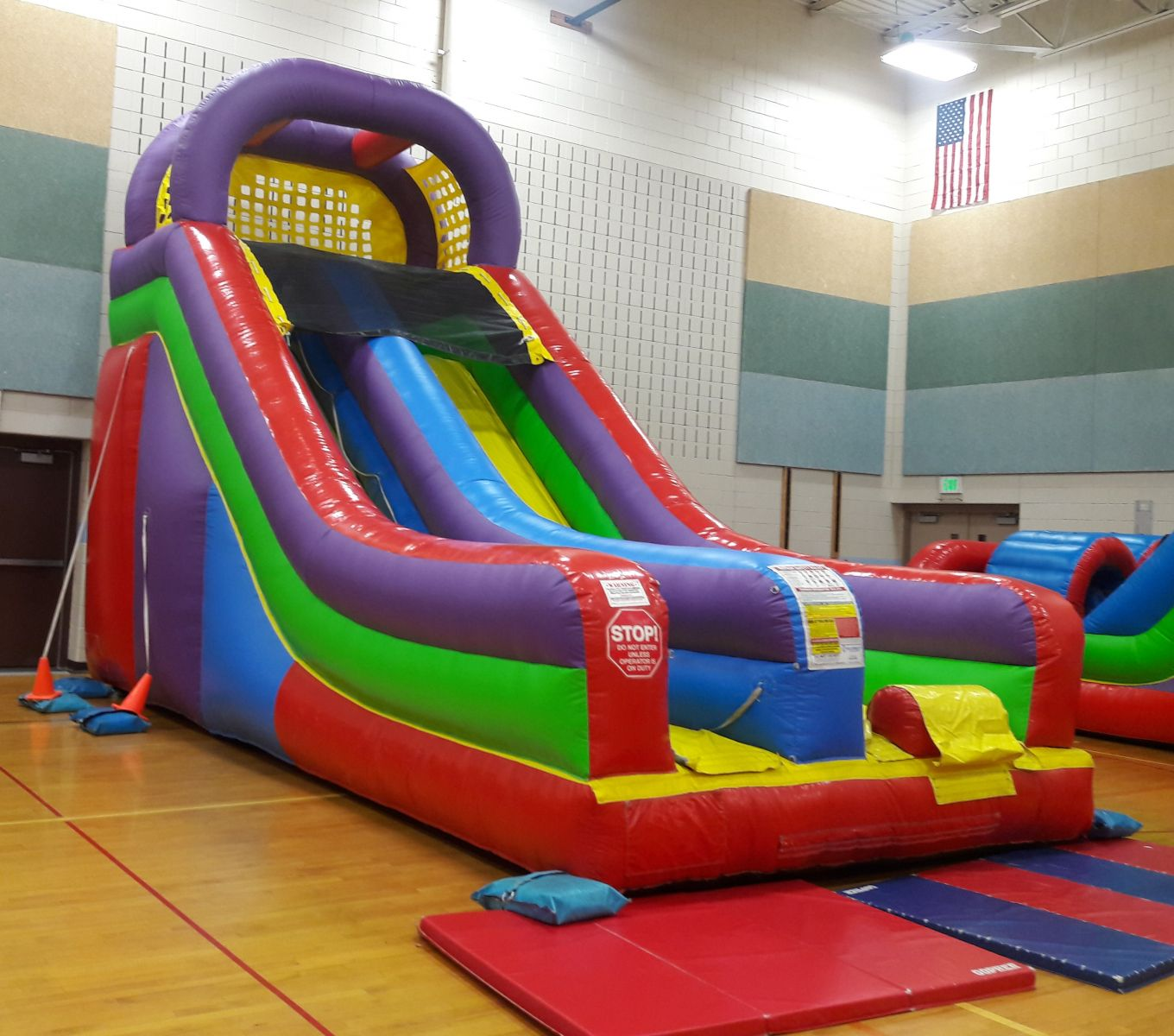 Inflatable dry slide inside school gym