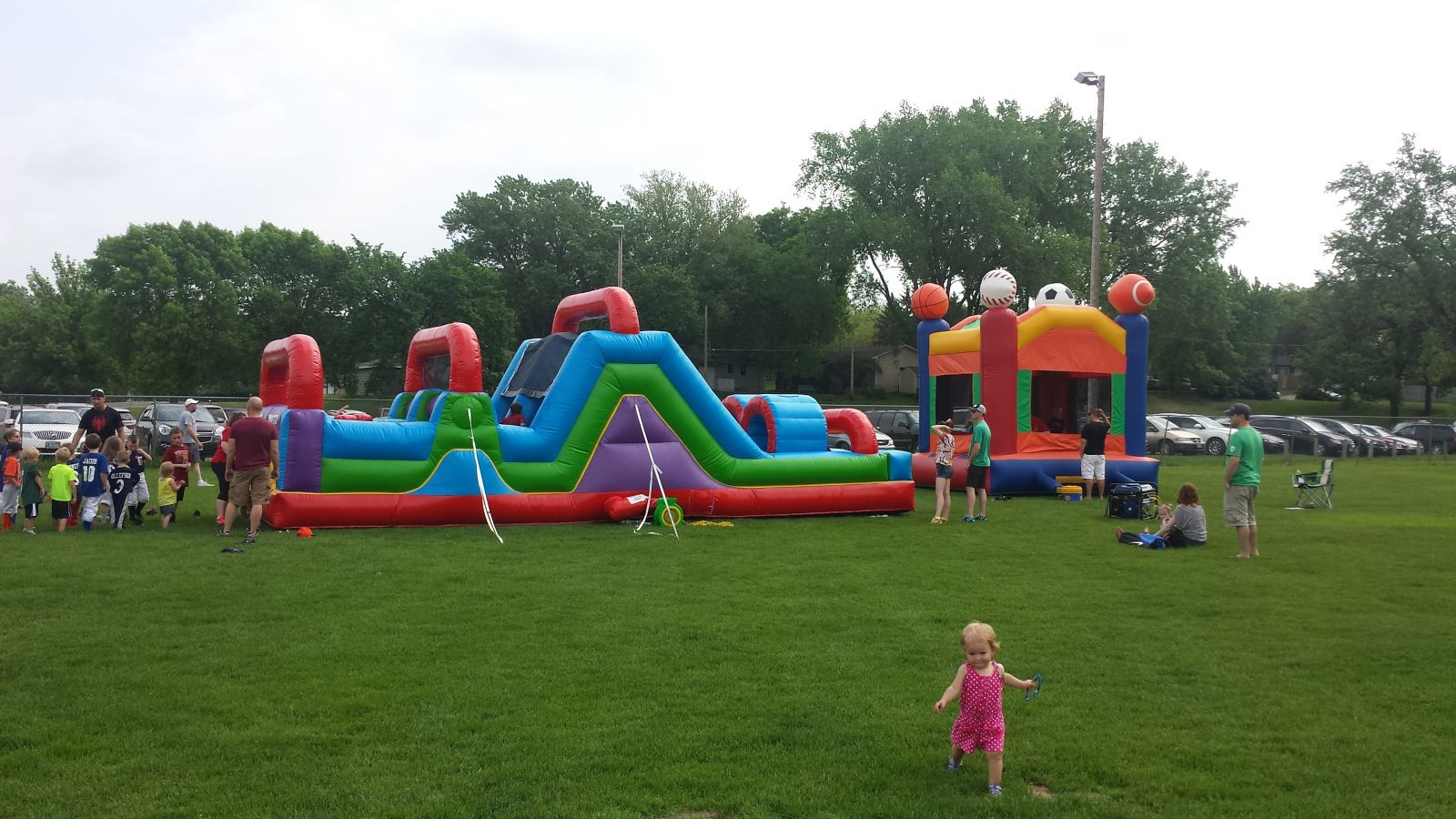 Wacky 7 Element Obstacle Course and Sports Bounce House at baseball event.