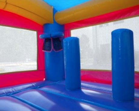 Pink and blue basketball hoop bounce house rental