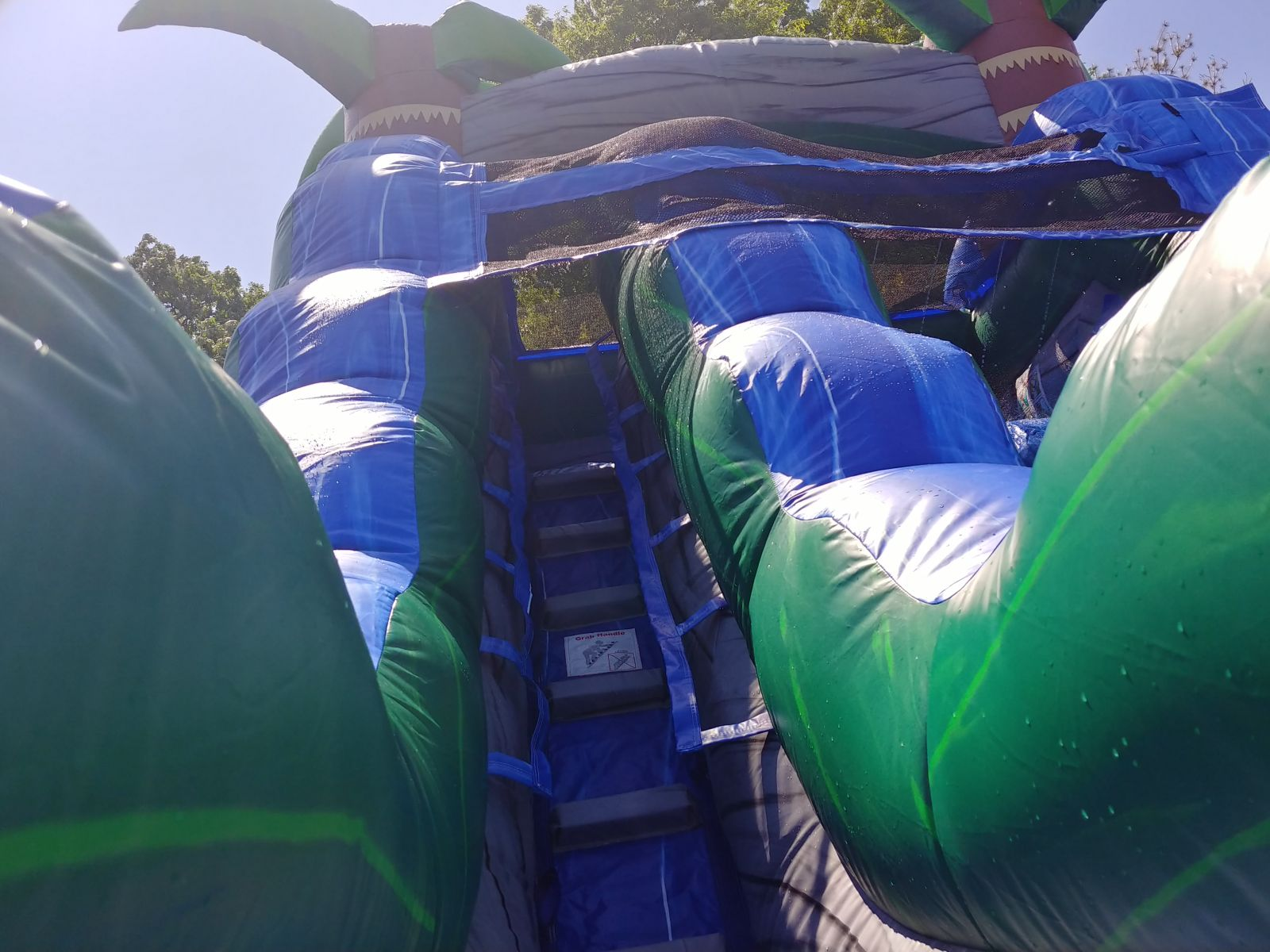 Blue Crush Water Slide Rental has easy-climb stairs to the top