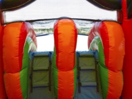 Climbing wall inside dual-lane combo bounce house rental