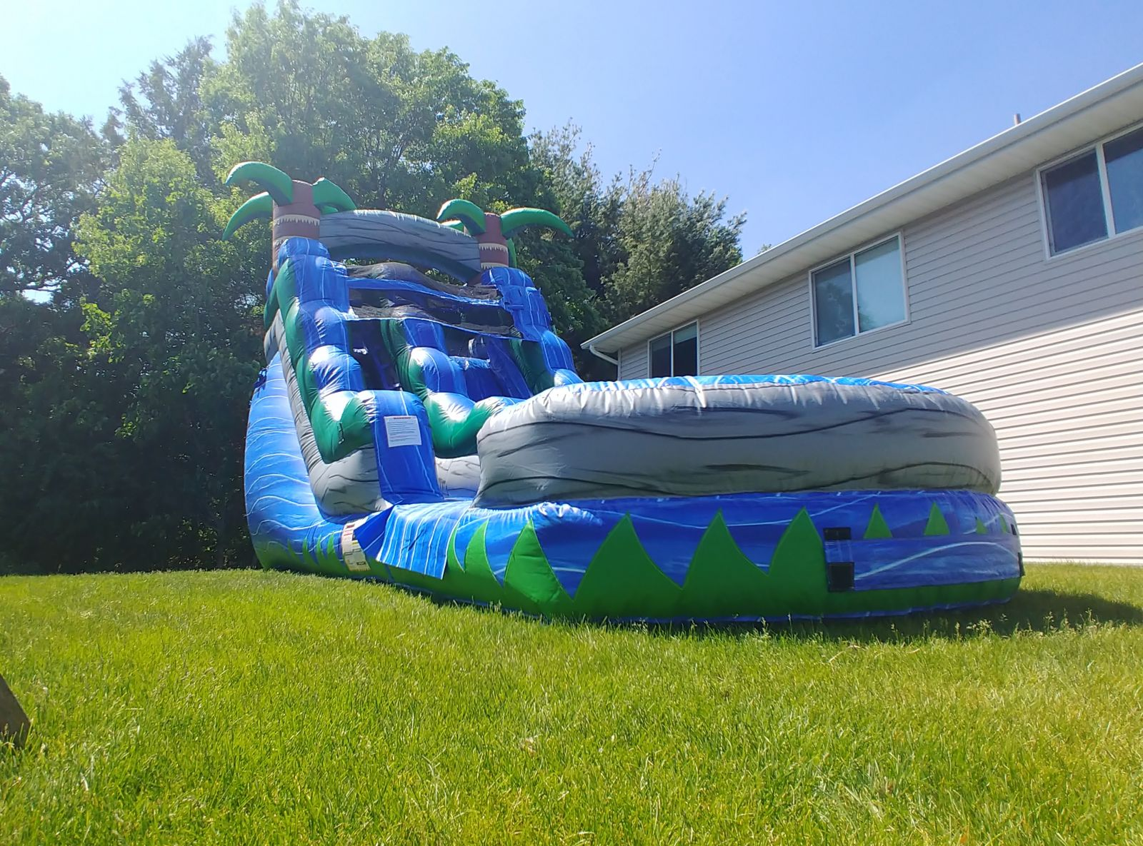 Giant Water Slide Rental is as tall as house