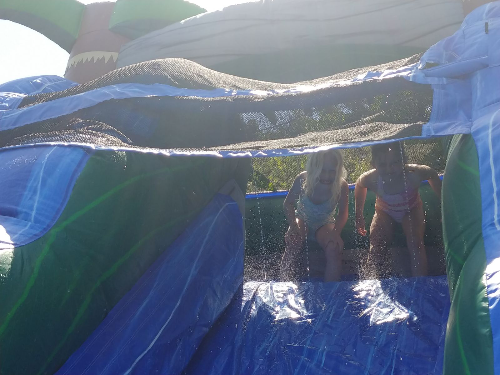 Water fall on top of slide rental with kids