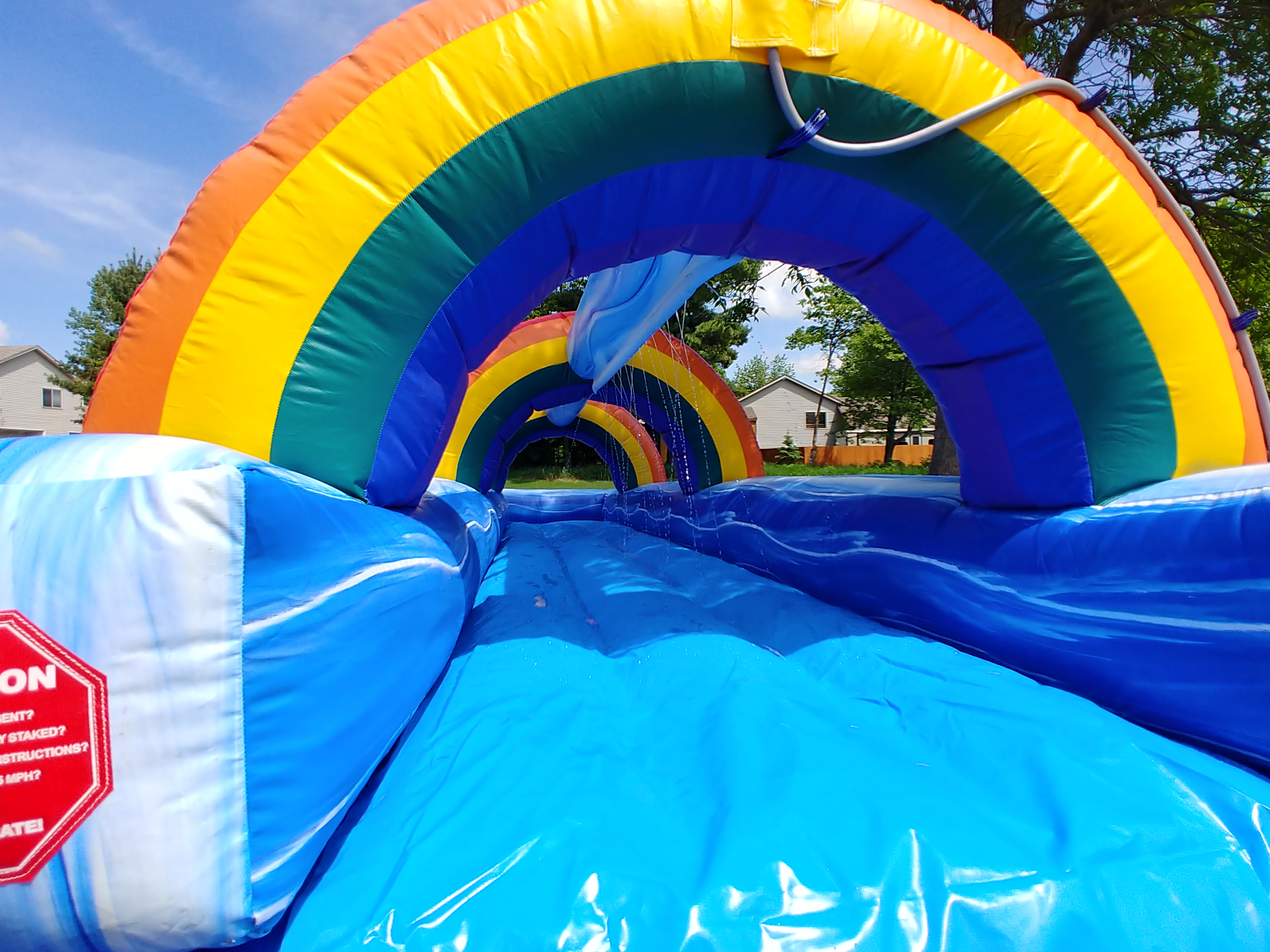 Your garden hose connects to make a constant flow of water over the slip-n-slide.