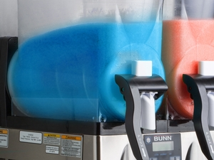 Frozen Drink machine with blue slushi and red slushi side by side