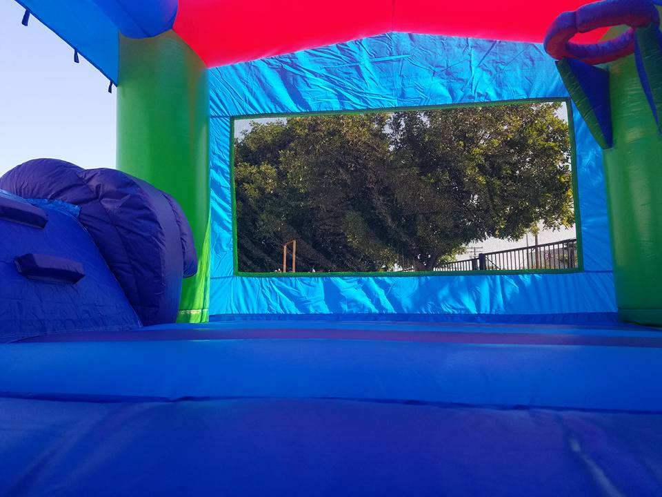 Bounce house interior with inflatable basketball hoop