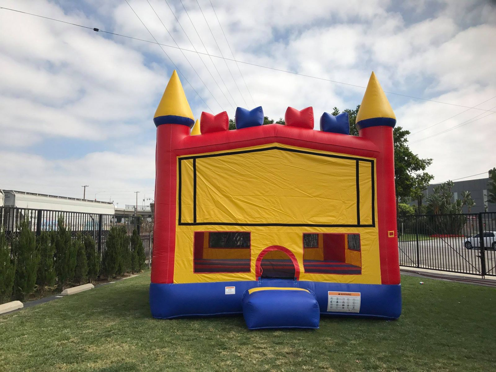 Bounce House Inflatable Castle outdoors on sunny day