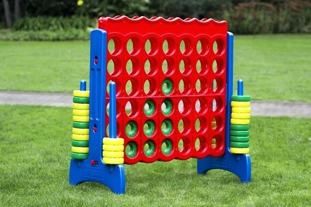 Giant Connect Four in a Row game on Grass lawn