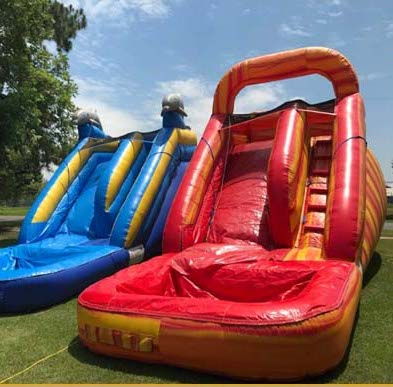 Inflatable water slide setup outdoors on a sunny afternoon