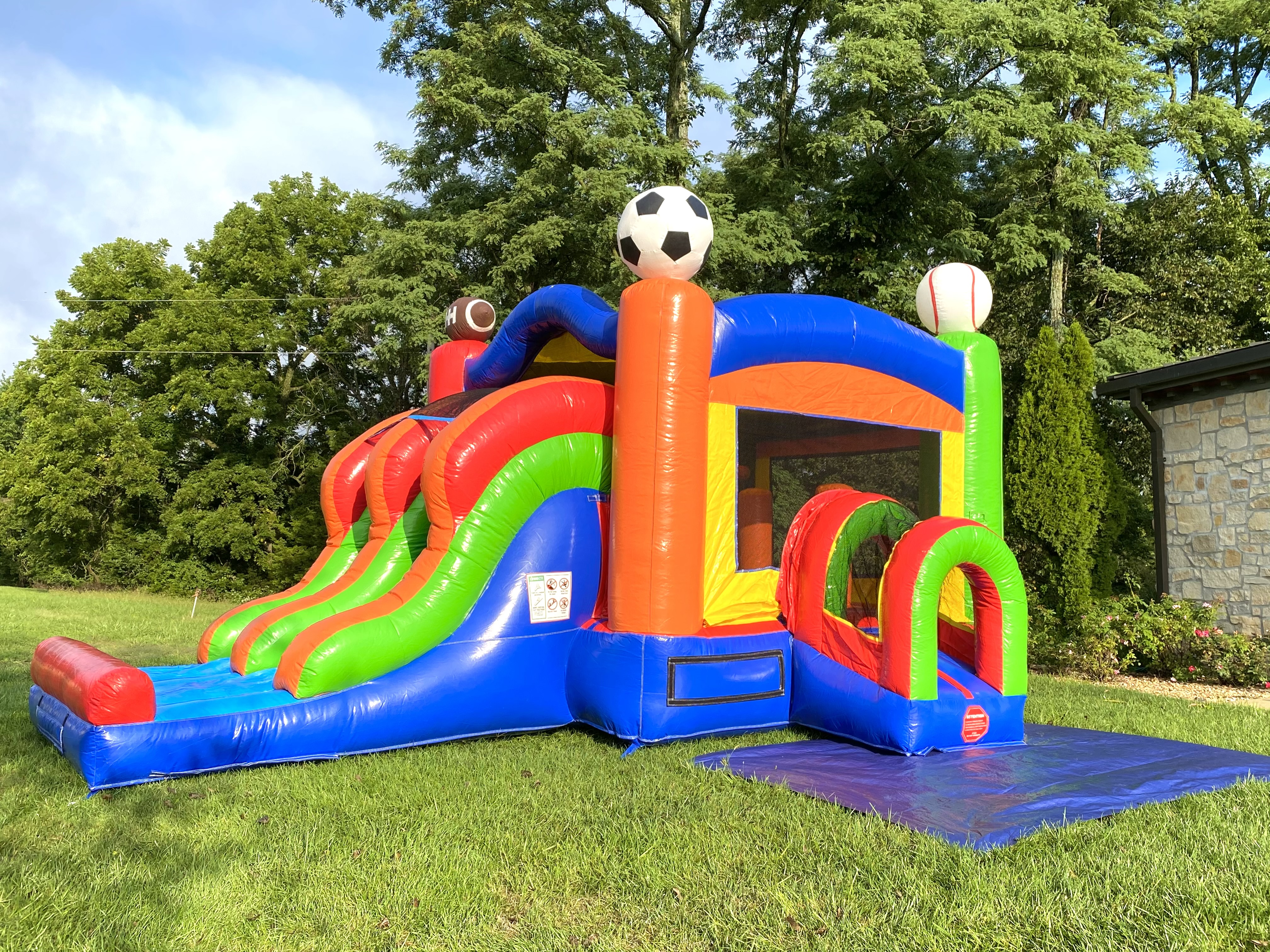 Sports theme bounce house with water slide
