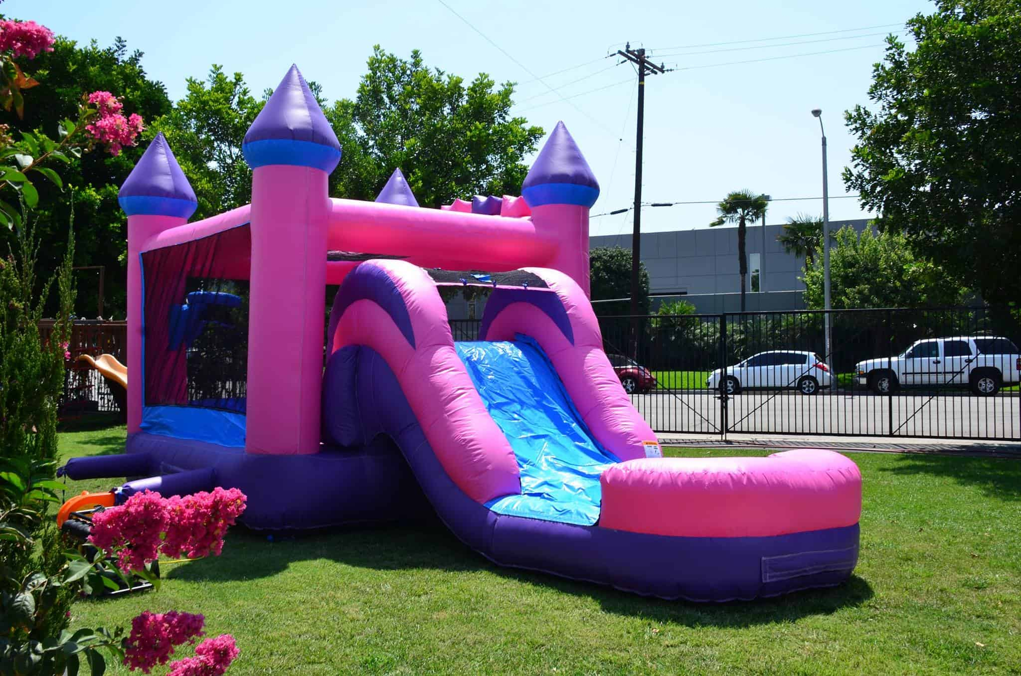 Pink castle bounce house with water slide