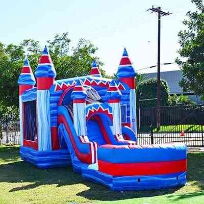 Inflatable water slide on green grass.