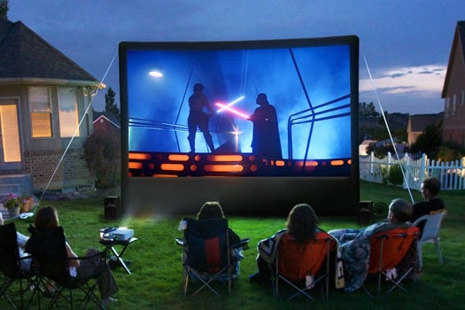 Outdoor Movie with a group of kids watching.