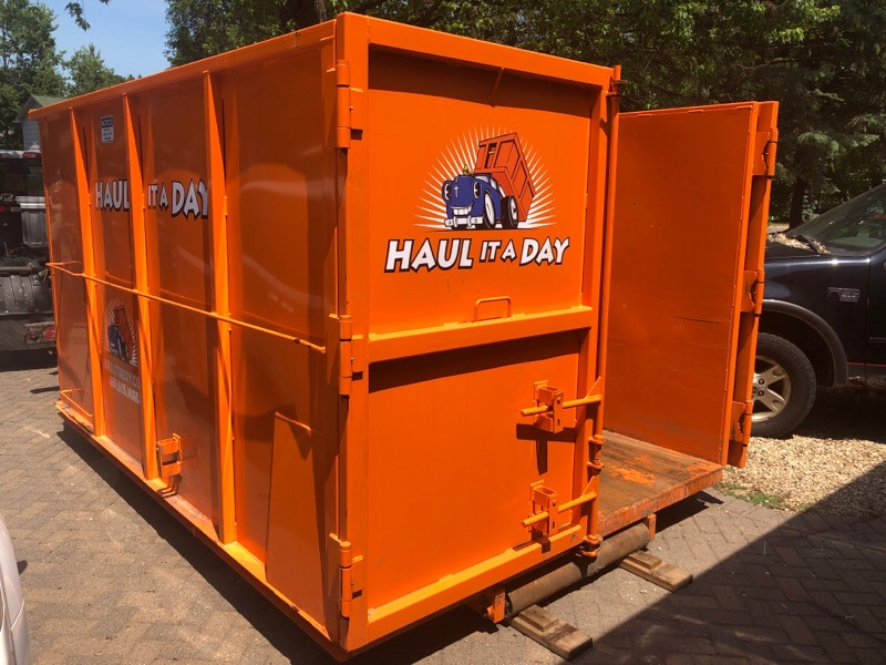 Photo of Orange Haul it a Day 20 Yard Rolloff Dumpster Rental with open double door